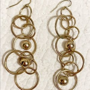 Dangly gold tone earrings